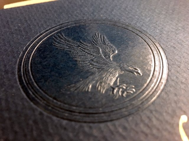 Clear/combo embossed Eagle Seal